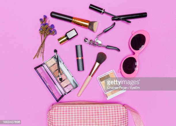high angle view of beauty products on pink background - hergestellter gegenstand stock-fotos und bilder