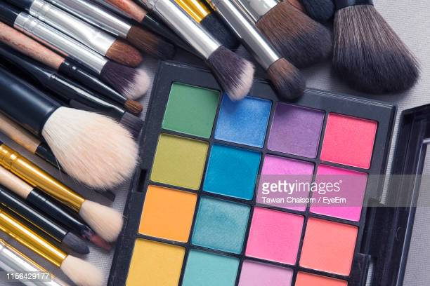 high angle view of beauty products on table - eyeshadow stock pictures, royalty-free photos & images