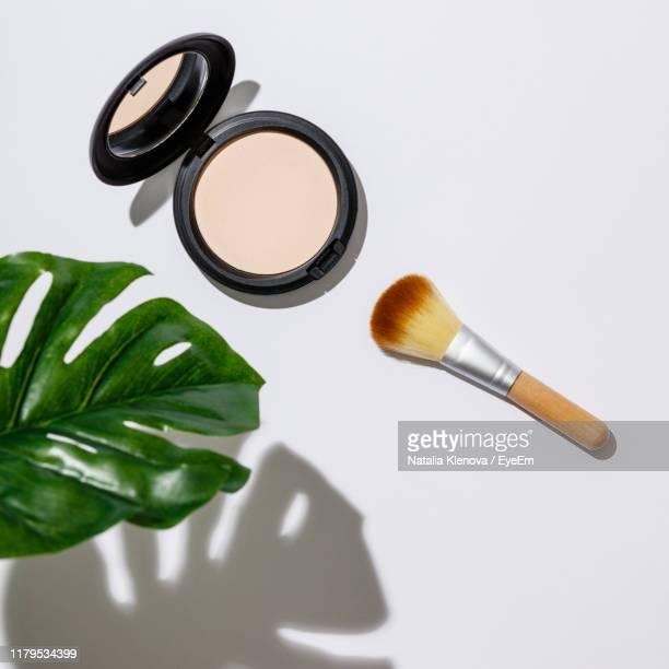high angle view of beauty products on table - powder compact stock pictures, royalty-free photos & images