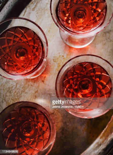 high angle view of beer glass on table - liqueur stock pictures, royalty-free photos & images