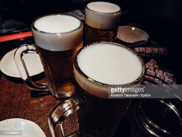 High Angle View Of Beer Glasses On Table