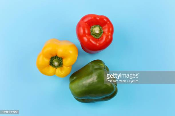 High Angle View Of Bell Peppers Over Blue Background