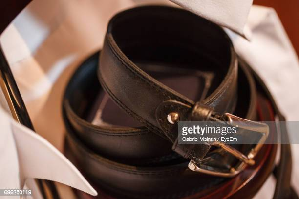 high angle view of belt rolled up - leather belt stock pictures, royalty-free photos & images