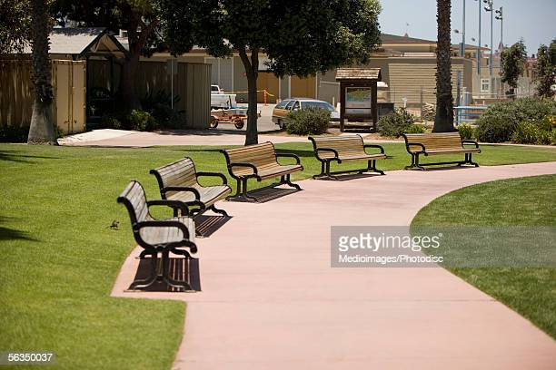 high angle view of benches lining the glorietta bay seawall, san diego, california, usa - seawall stock pictures, royalty-free photos & images