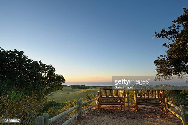 High angle view of benches over looking iSimangaliso Wetland Park and Indian ocean. St Lucia, Kwazulu Natal, South Africa