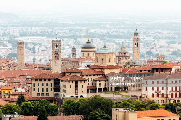 high angle view of bergamo citta alta skyline with medieval towers, lombardy, italy - bergamo alta foto e immagini stock
