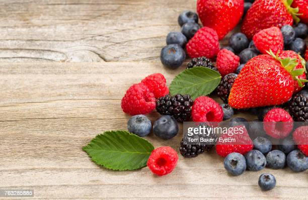 high angle view of berries on table - berry fruit stock pictures, royalty-free photos & images