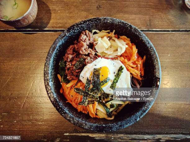 High Angle View Of Bibimbab In Bowl On Table