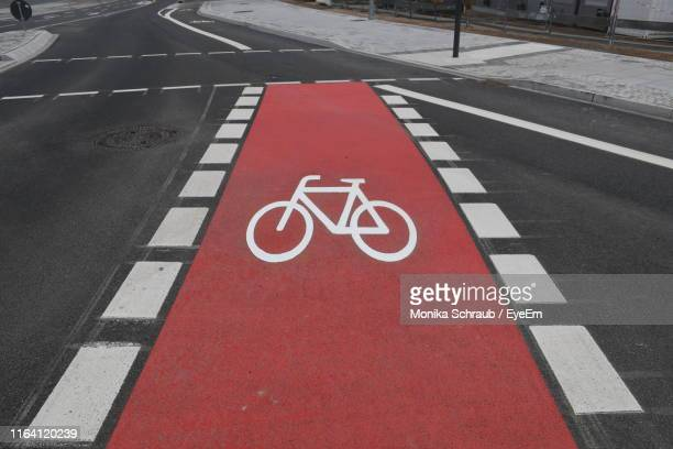 high angle view of bicycle lane in city - bicycle lane stock pictures, royalty-free photos & images