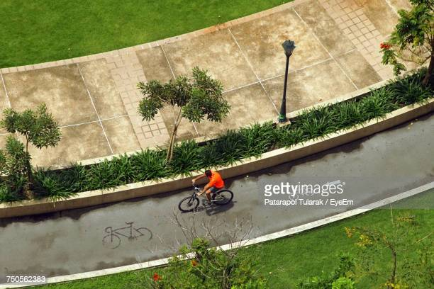 high angle view of bicycle on bike lane - bicycle lane stock pictures, royalty-free photos & images
