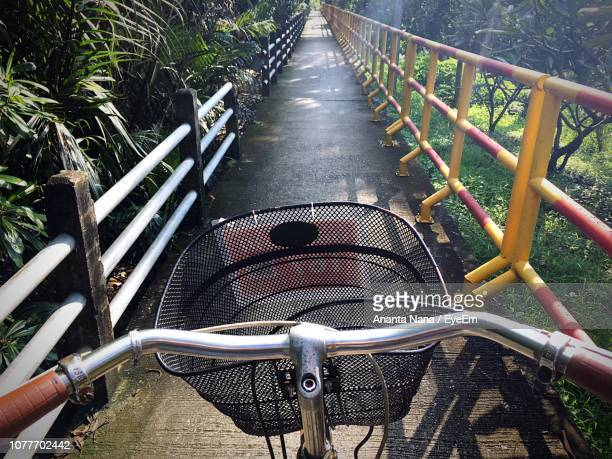 High Angle View Of Bicycle On Footpath At Park
