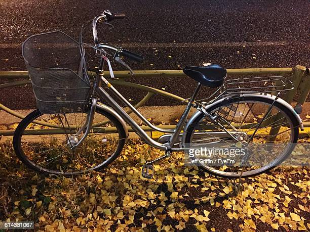 High Angle View Of Bicycle On Leaves Covered Field During Autumn