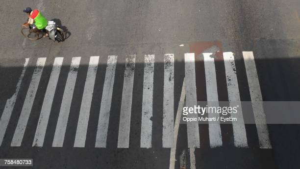 high angle view of bicycle on road in city - oppie muharti stock pictures, royalty-free photos & images