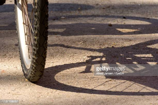 high angle view of bicycle on road - alfred jansen imagens e fotografias de stock