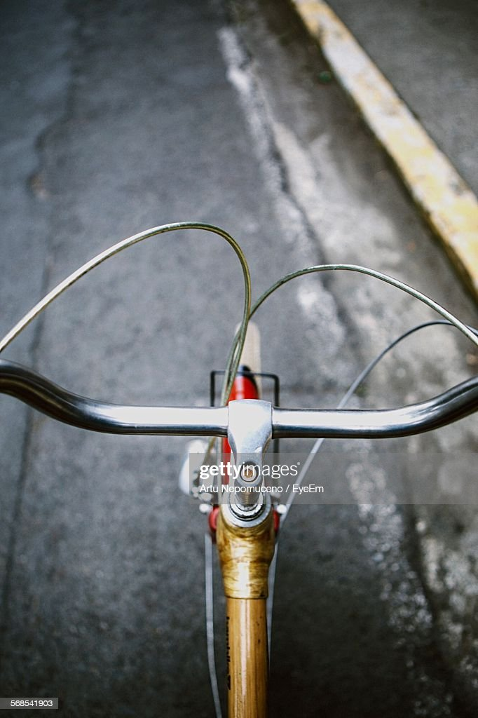 High Angle View Of Bicycle On Street : Stock Photo