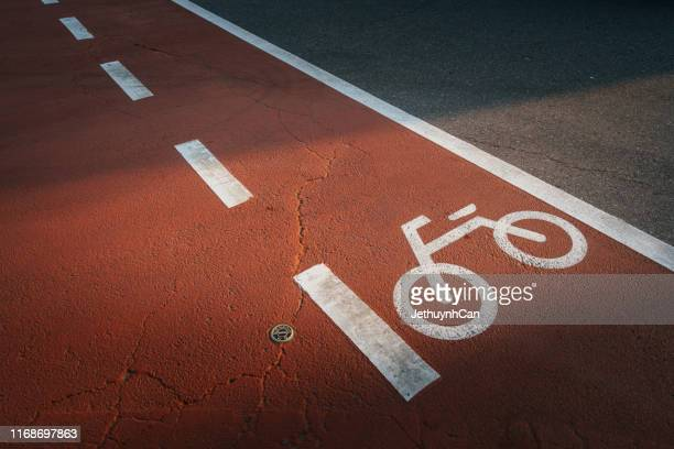 high angle view of bicycle sign on road - bicycle lane stock pictures, royalty-free photos & images