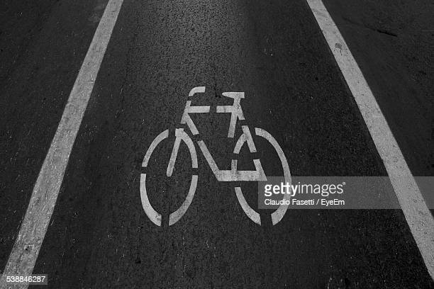 High Angle View Of Bicycle Symbol On Street