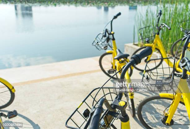 High Angle View Of Bicycles Parked By Lake