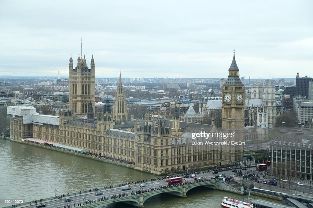High Angle View Of Big Ben By River Thames Against Sky In City : Stock Photo