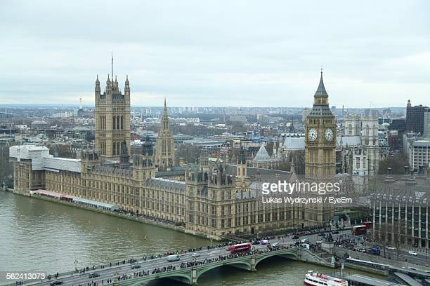 High Angle View Of Big Ben By River Thames Against Sky In City