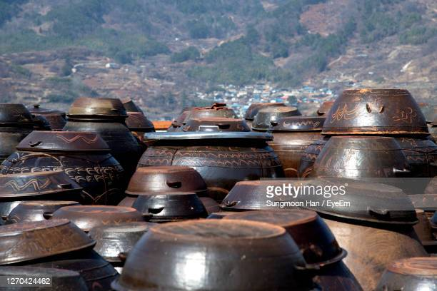 high angle view of big jars against mountain - gwangju stock pictures, royalty-free photos & images