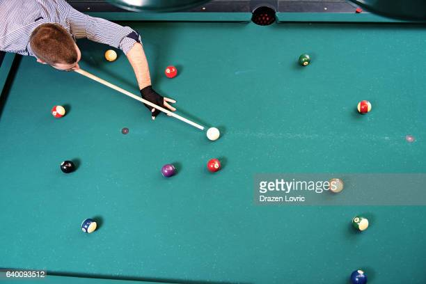 High angle view of billiard game player