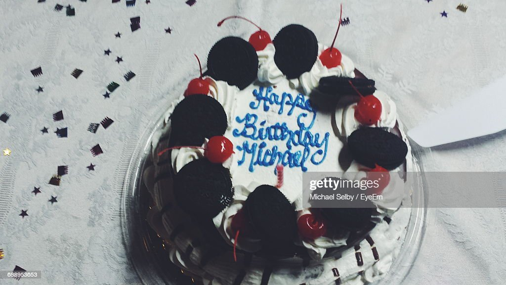High Angle View Of Birthday Cake With Text On Table Stock Photo