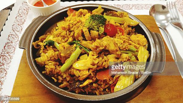 High Angle View Of Biryani In Container On Table