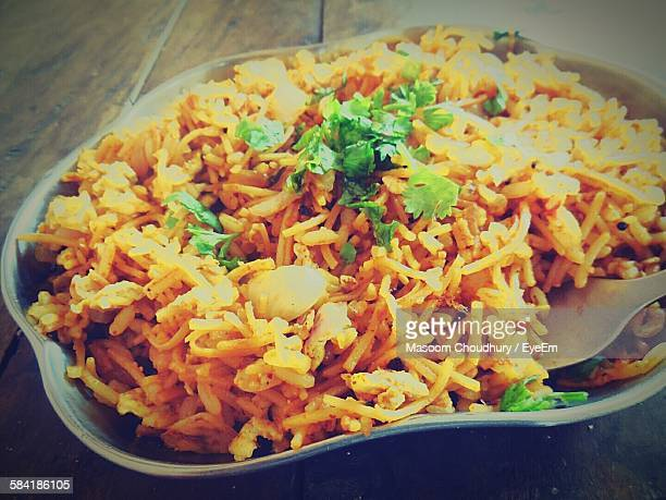 High Angle View Of Biryani In Container