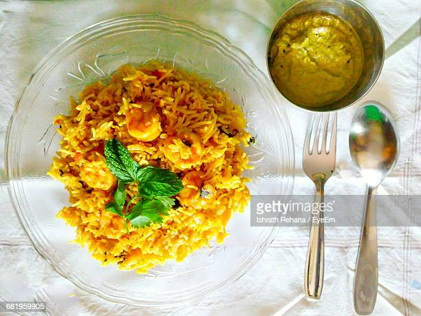 high angle view of biryani in plate on table - biryani stock photos and pictures