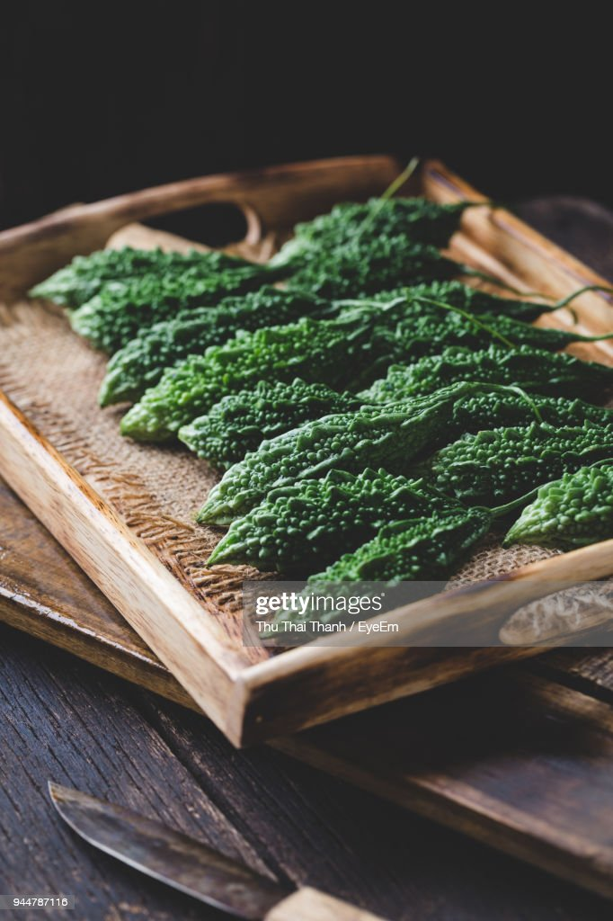 High Angle View Of Bitter Gourds On Table : Stock Photo