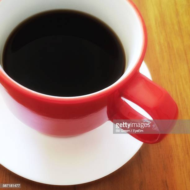 High Angle View Of Black Coffee In Cup On Table