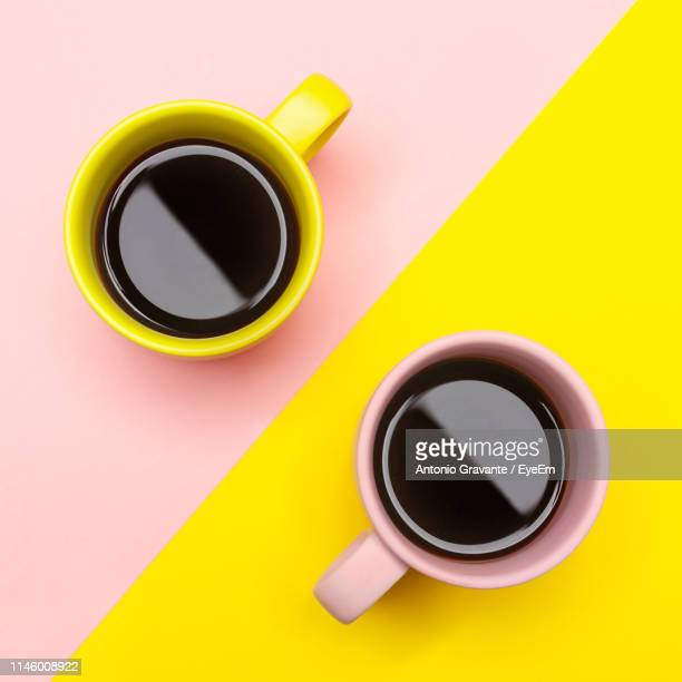 high angle view of black coffee on colored background - two tone color stock pictures, royalty-free photos & images