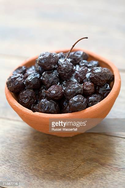High Angle View of Black Olives Preserved in Salt in a Ceramic Bowl