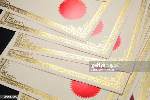 high angle view of blank certificates on table - certificate stock pictures, royalty-free photos & images