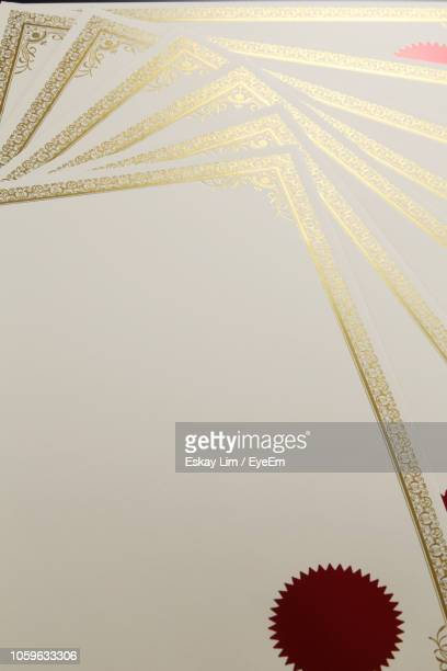high angle view of blank certificates on table - graduation background stock pictures, royalty-free photos & images