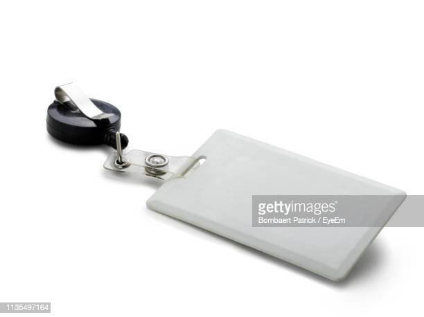 high angle view of blank id card against white background - identity card stock pictures, royalty-free photos & images