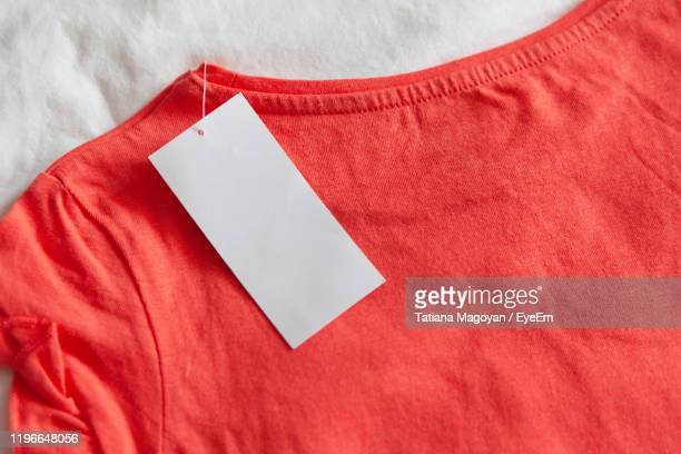 high angle view of blank label on t-shirt - label stock pictures, royalty-free photos & images