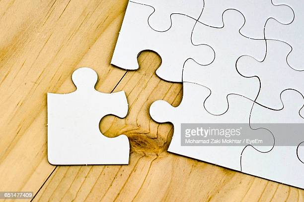 High Angle View Of Blank Puzzle Piece On Table