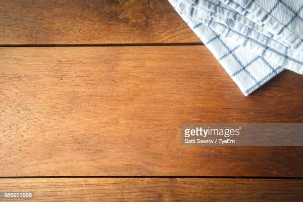 high angle view of blanket on floorboard - floorboard stock photos and pictures
