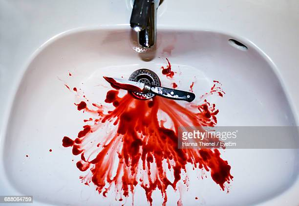 High Angle View Of Blood With Knife In Sink