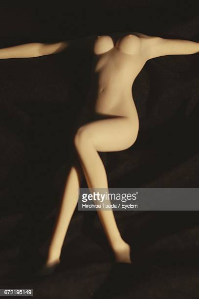 high angle view of blow-up doll on bed - blow up doll stock pictures, royalty-free photos & images