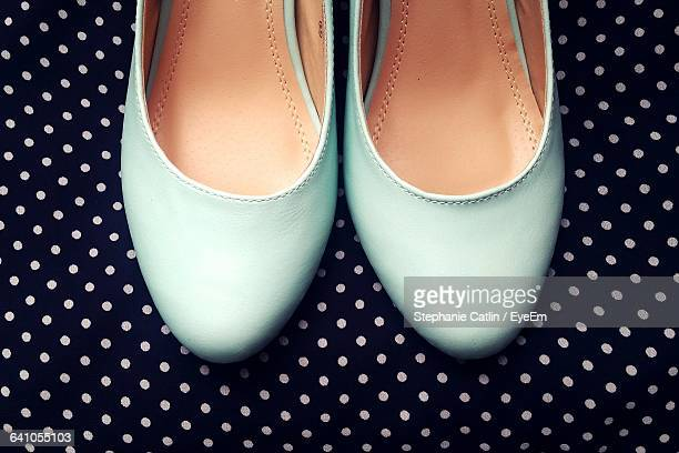 High Angle View Of Blue Flat Shoes On Patterned Floor