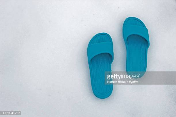 high angle view of blue flip-flops on floor - flip flop stock pictures, royalty-free photos & images