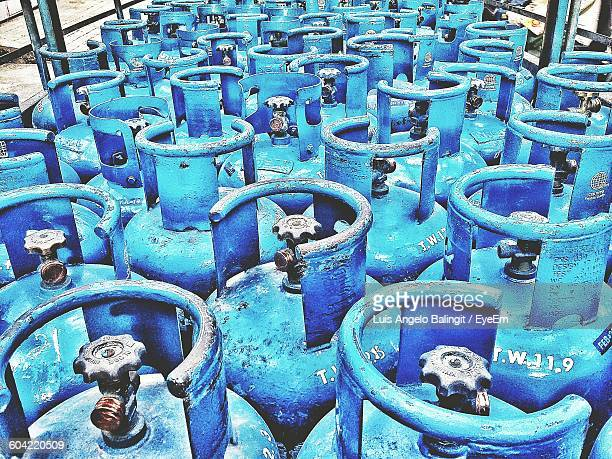 high angle view of blue gas cylinders - cylinder stock pictures, royalty-free photos & images
