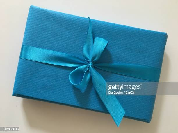 high angle view of blue gift box on table - gift box stock pictures, royalty-free photos & images