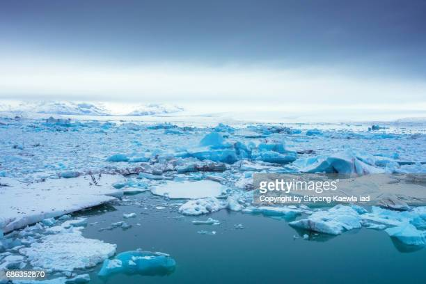 High angle view of blue icebergs in glacier lake at Jökulsárlón, Iceland.