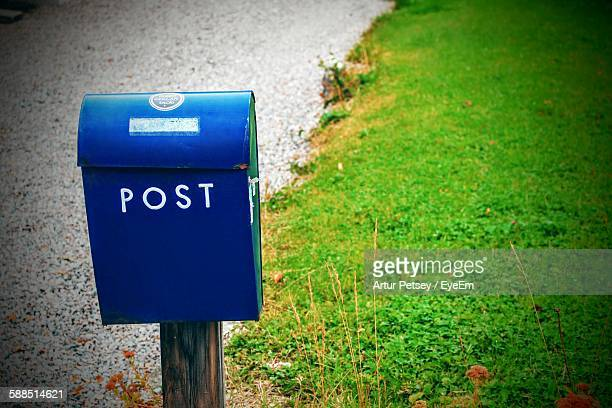 High Angle View Of Blue Mailbox With Post Text