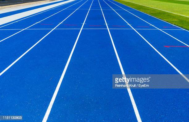 high angle view of blue sports track - track and field stadium stock pictures, royalty-free photos & images
