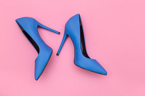High Angle View Of Blue Stilettos Over Pink Background - gettyimageskorea
